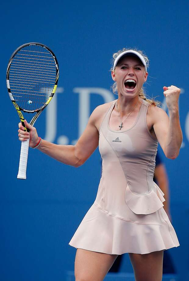 Caroline Wozniacki celebrates after match point in her fourth-round victory over Maria Sharapova. Photo: Chris Trotman, Getty Images For USTA