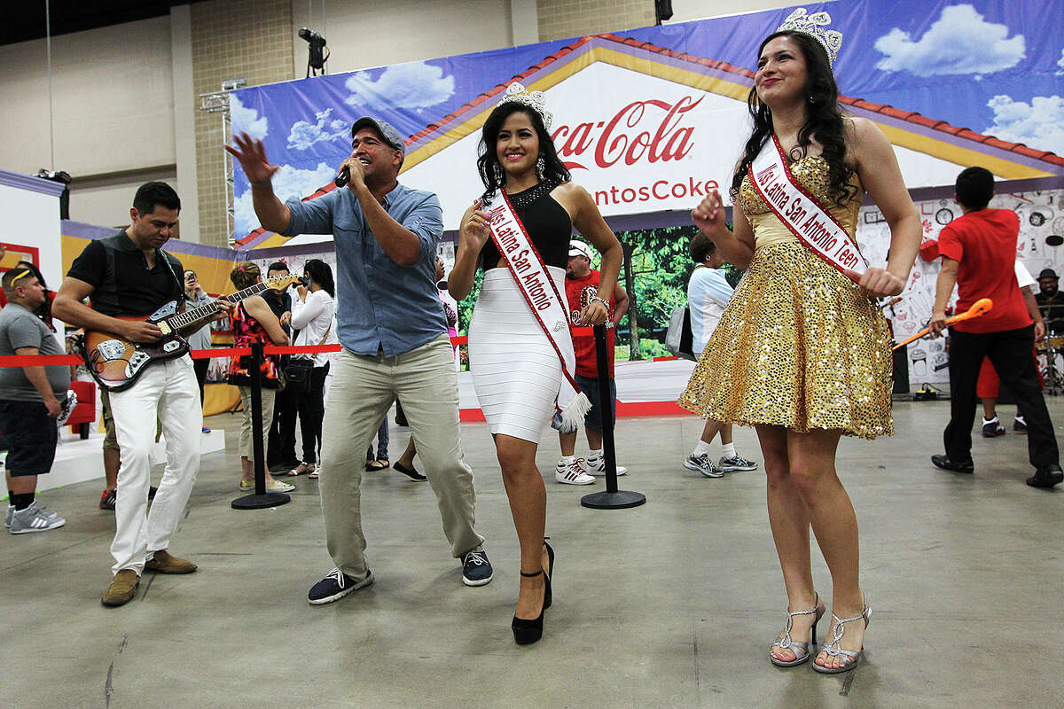 Miss Latina San Antonio Daniella Renee Espinoza, center, and Miss Latina San Antonio Teen Alyssa Salinas, right, dance as Ray Colao sings during the People En Espanol Festival at the Henry B. Gonzalez Convention Center, Sunday, August 31, 2014.