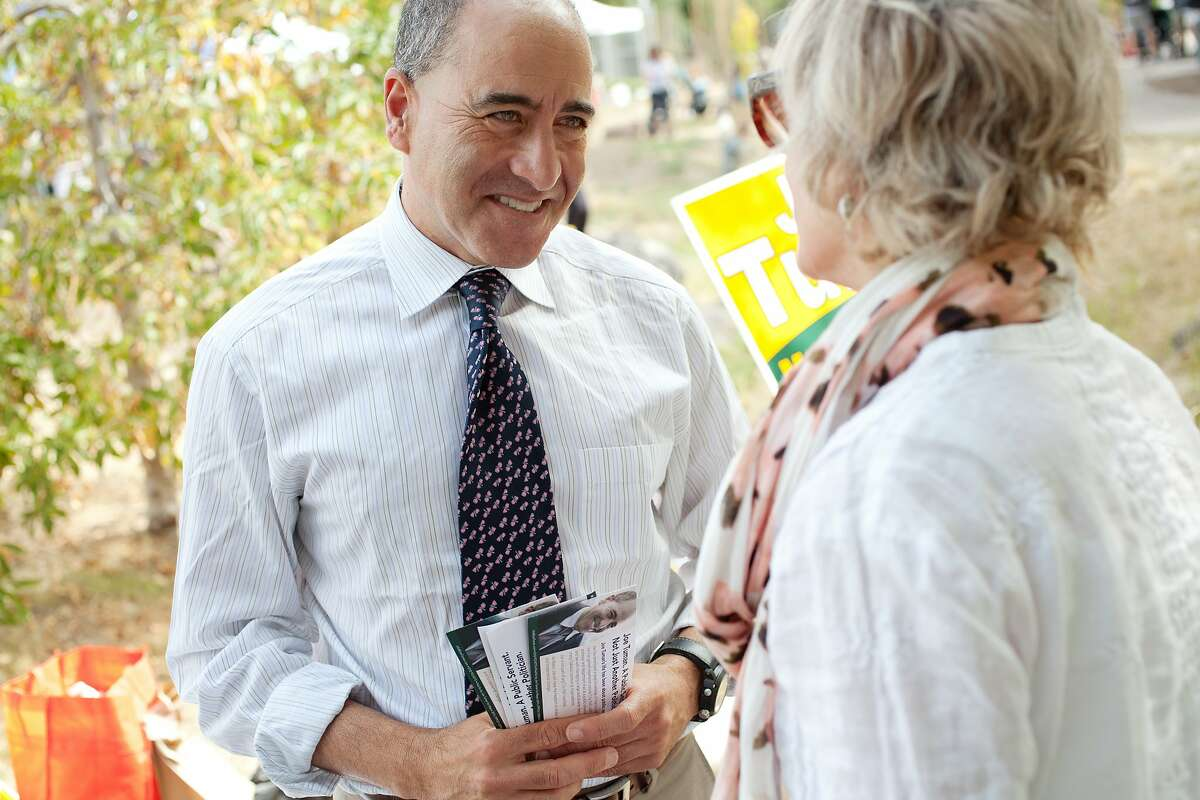 Oakland Mayoral candidate Joe Tuman speaks with local voters at the Temescal Farmers' Market in Oakland, Calif., August 24, 2014. Tuman, a professor at San Francisco State University, ran for Mayor of Oakland in 2010 finishing 4th in the election.
