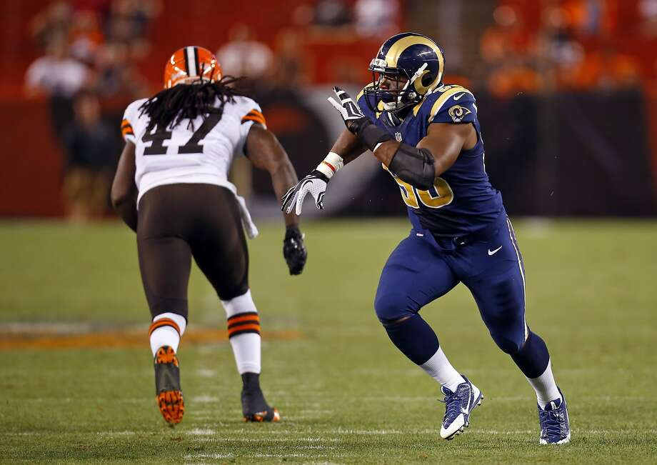 St. Louis Rams defensive end Michael Sam (96) rush past Cleveland Browns tight end MarQueis Gray (47) during a preseason NFL football game Saturday, Aug. 23, 2014, in Cleveland.  (Jeff Haynes/AP Images for Panini) Photo: Jeff Haynes, Associated Press