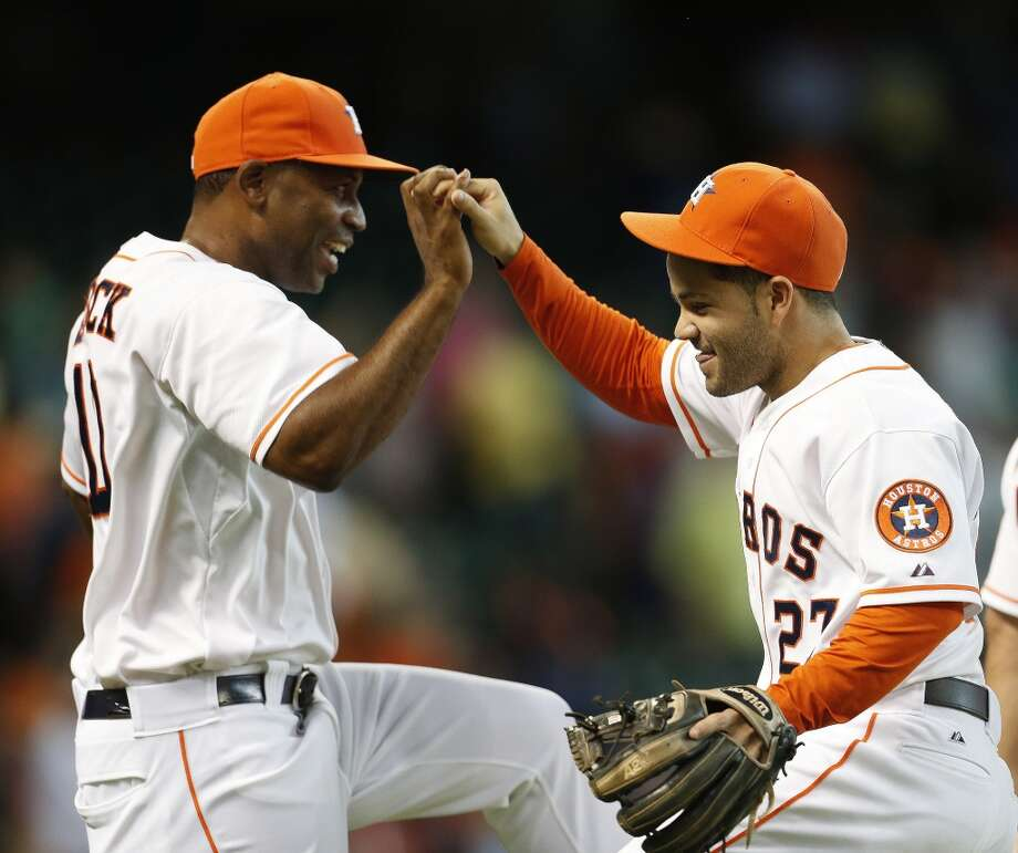 August 31: Astros 3, Rangers 2 Astros second baseman Jose Altuve and first base coach Tarrik Brock celebrate the win. Photo: Karen Warren, Houston Chronicle