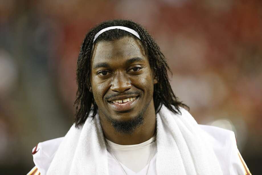 Washington Redskins quarterback Robert Griffin III (10) walks the sidelines during a NFL preseason football game against the Tampa Bay Buccaneers  Thursday, Aug. 28, 2014, in Tampa, Fla. (AP Photo/Brian Blanco) Photo: Brian Blanco, Associated Press