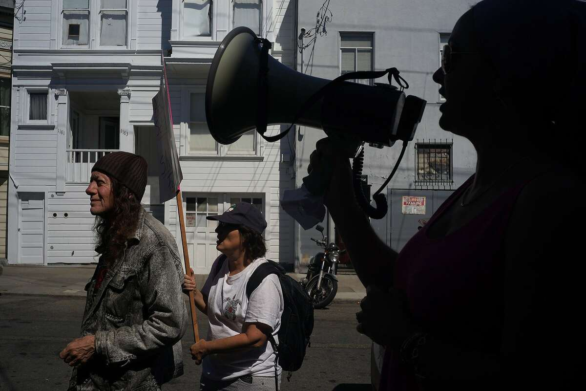 Protesters rally against the Fong family for evictions in the Mission on Saturday, Aug. 15, 2014 in San Francisco, Calif. The Silva-Lainez family has been the victim of attempted evictions three times by their landlord Leona Fong.