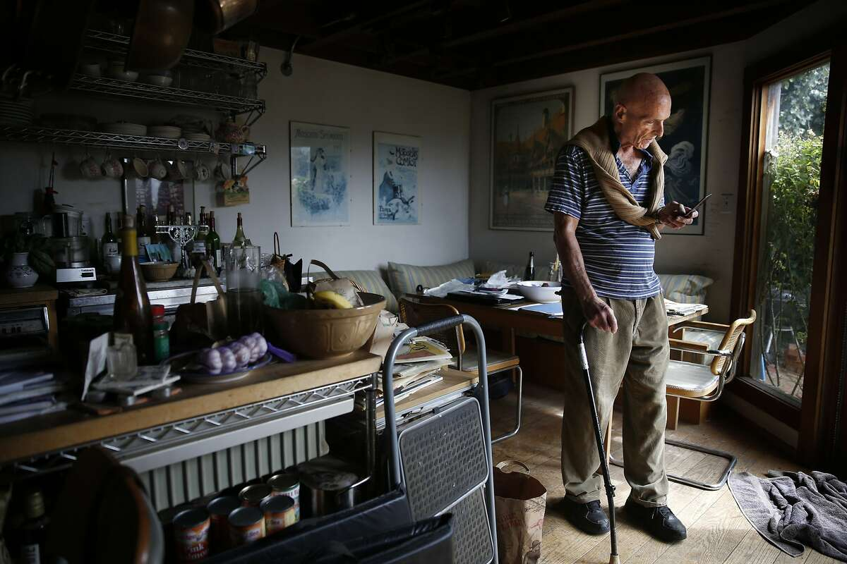 Jerrold Jacoby takes a phone call in his Russian Hill home on Friday, August 22, 2014 in San Francisco, Calif. Jacoby recently evicted a tenant so that his daughter could move in and take care of him as he ages.