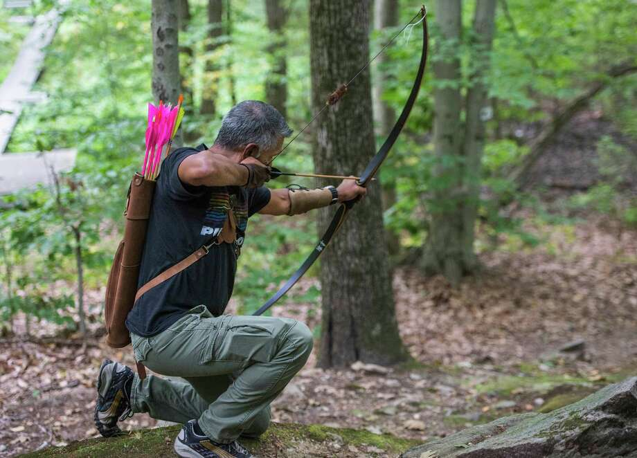Kreesan Pillay a member of the Cos Cob Archers, aims at a target using a traditional longbow during the open shoot day held at their site off of Bible Street, in the Cos Cob section of Greenwich, CT on Sunday, August, 31st, 2014. Photo: Mark Conrad / Greenwich Time
