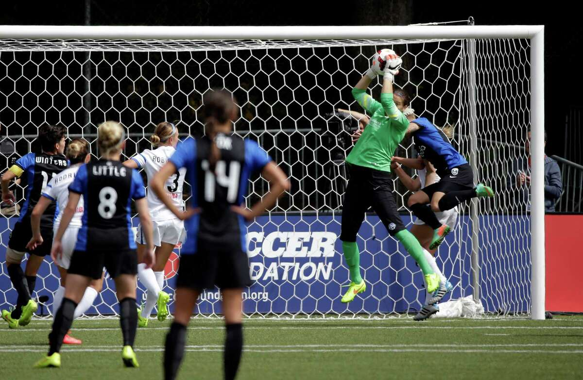 FC Kansas City goalie Sara Keane, makes a stop against the Seattle Reign FC in the second half of the NWSL championship soccer match Sunday, Aug. 31, 2014, in Tukwila, Wash. Kansas City won 2-1.