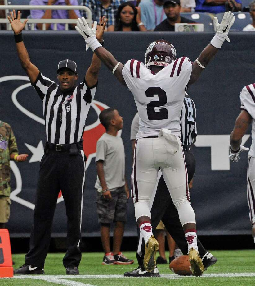 TSU's Malik Cross (2) signals his touchdown with an official during the first half of the Labor Day Classic against Prairie View A&M, Sunday, August 31, 2014, at NRG Stadium in Houston. Photo: Eric Christian Smith, For The Chronicle / 2014 Eric Christian Smith