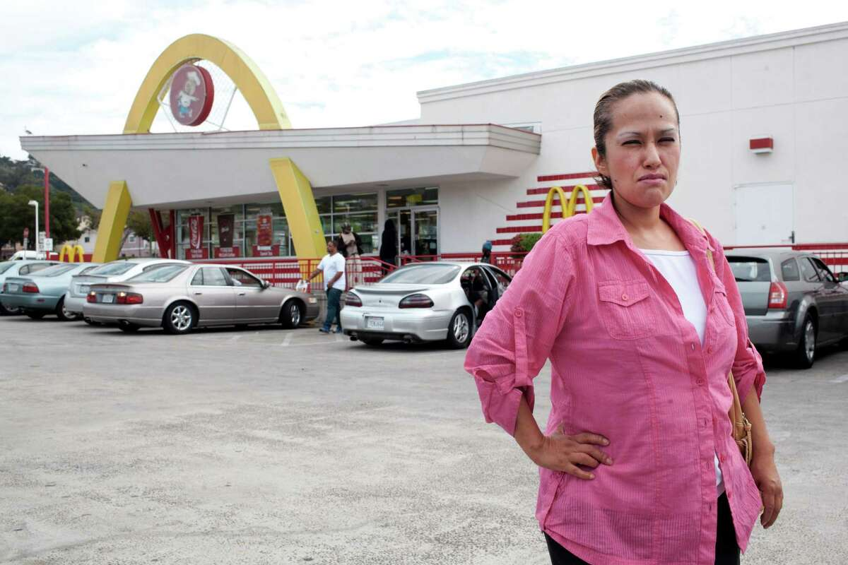 Guadalupe Salazar, a cashier at a McDonalds in Oakland, Calif., complains that her paychecks repeatedly missed a few hours of work time and overtime pay.
