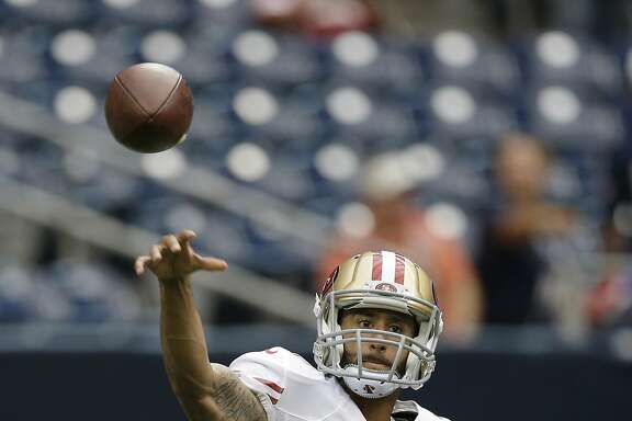 San Francisco 49ers' Colin Kaepernick throws before an NFL football preseason game against the Houston Texans, Thursday, Aug. 28, 2014, in Houston. (AP Photo/David J. Phillip)