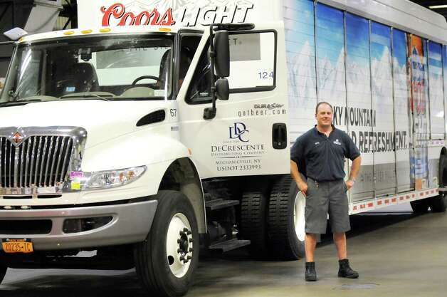 Driver supervisor Jerry Woitkoski stands by a company truck on Tuesday, Aug. 26, 2014, at DeCrescente Distributing Co. in Mechanicville, N.Y. DeCrescente has installed technology in its trucks that block drivers from being able to use mobile devices when the truck is in motion. (Cindy Schultz / Times Union) Photo: Cindy Schultz / 00028344A