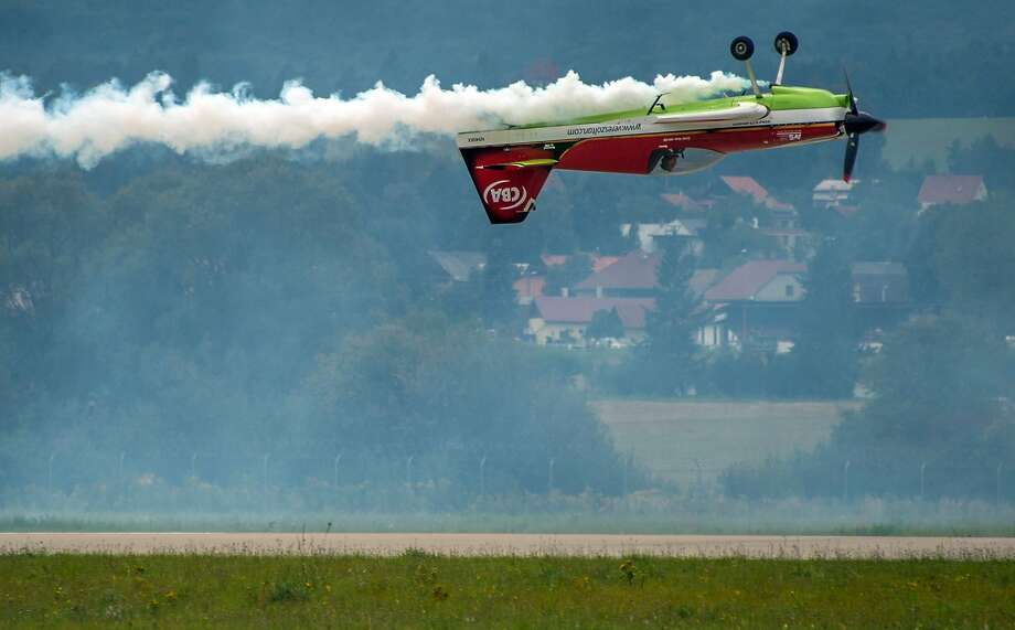 Landing the hard way: Legendary acrobatic pilot Zoltan Veres of Hungary shows he's equally adept at flying his stunt plane upside-down as he is piloting it right-side up at the Slovak International Air Fest SIAF in Sliac, Slovakia. Photo: Joe Klamar, AFP/Getty Images