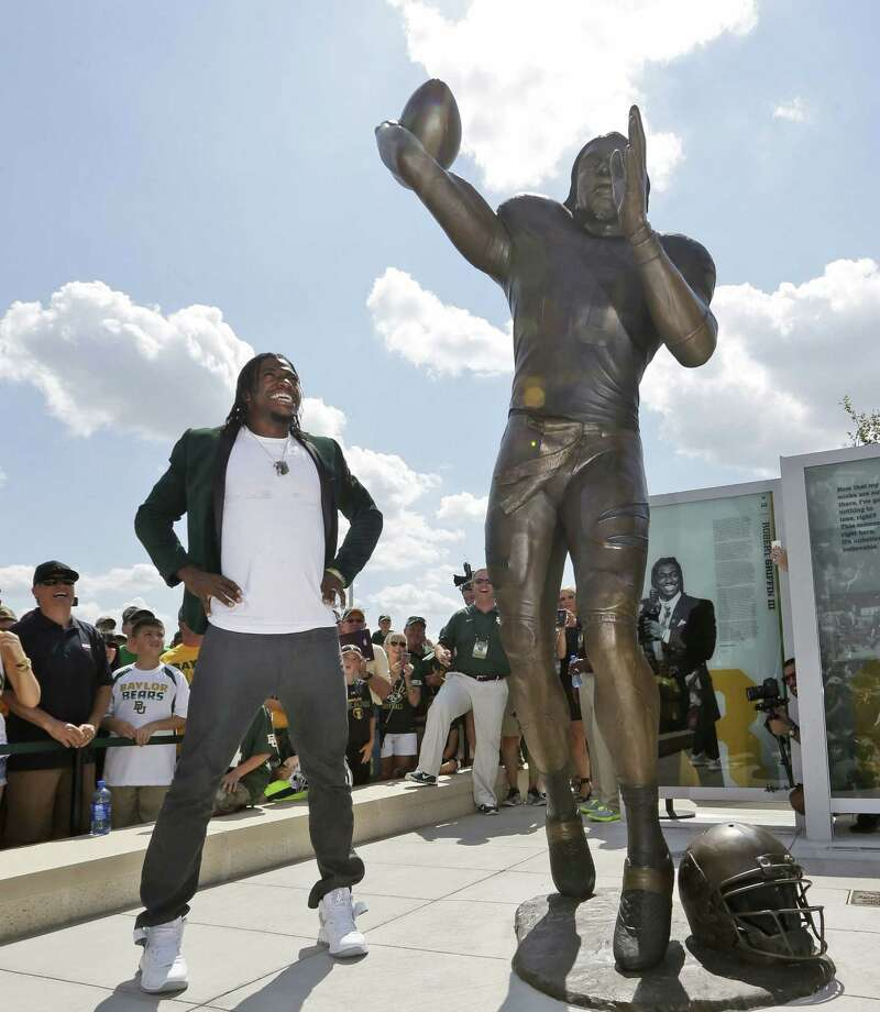 Robert Griffin III looks at his statue after Baylor unveiled it outside the new McLane Stadium on Sunday in Waco. Photo: LM Otero / Associated Press / AP