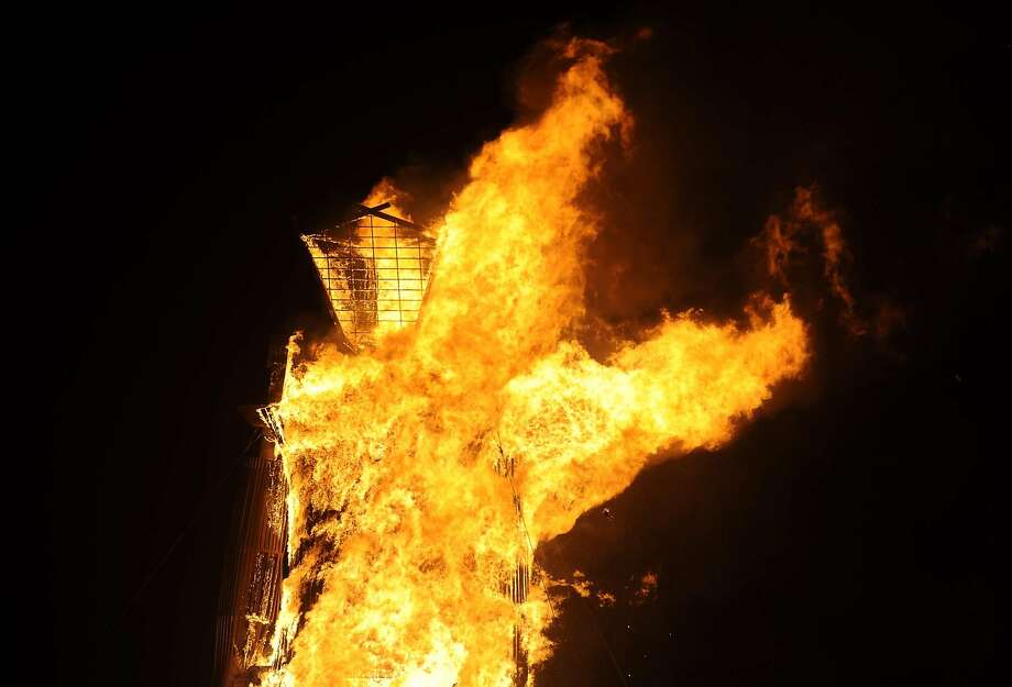 The man burns at the annual Burning Man event on the Black Rock Desert of Gerlach, Nevada on Aug. 30, 2014. Photo: Andy Barron, Associated Press