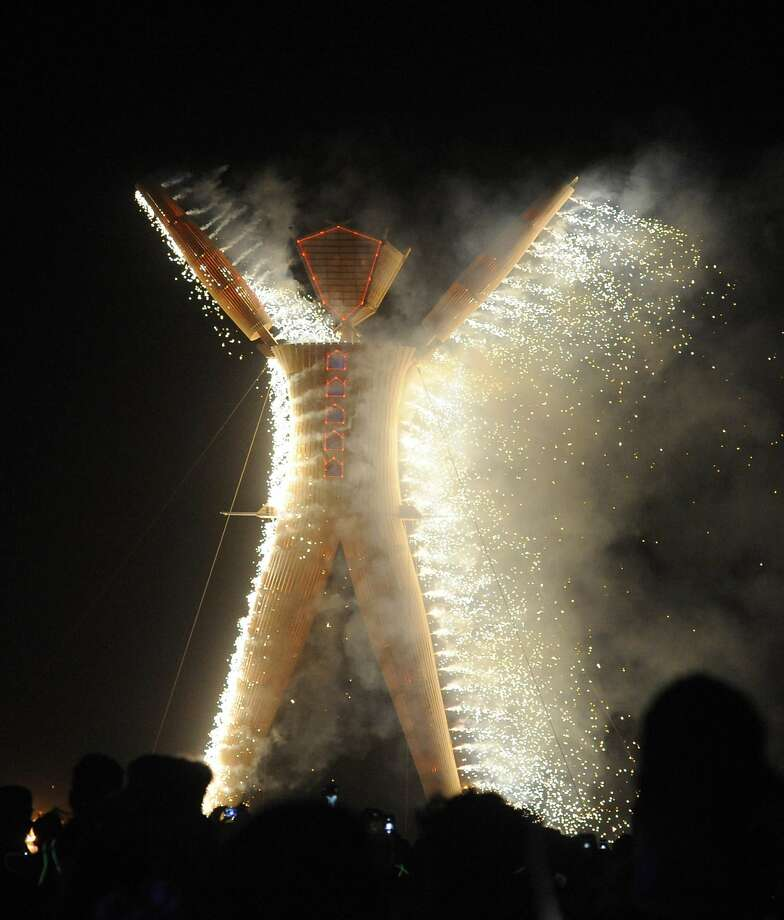 The man begins to burn at the annual Burning Man event on the Black Rock Desert of Gerlach, Nevada on Aug. 30, 2014. Photo: Andy Barron, Associated Press