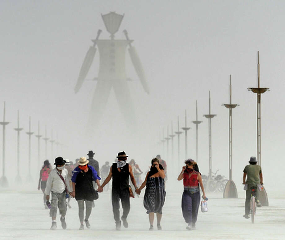 Burning Man participants walk through dust last year. Photo: Andy Barron / Associated Press / The Reno Gazette-Journal