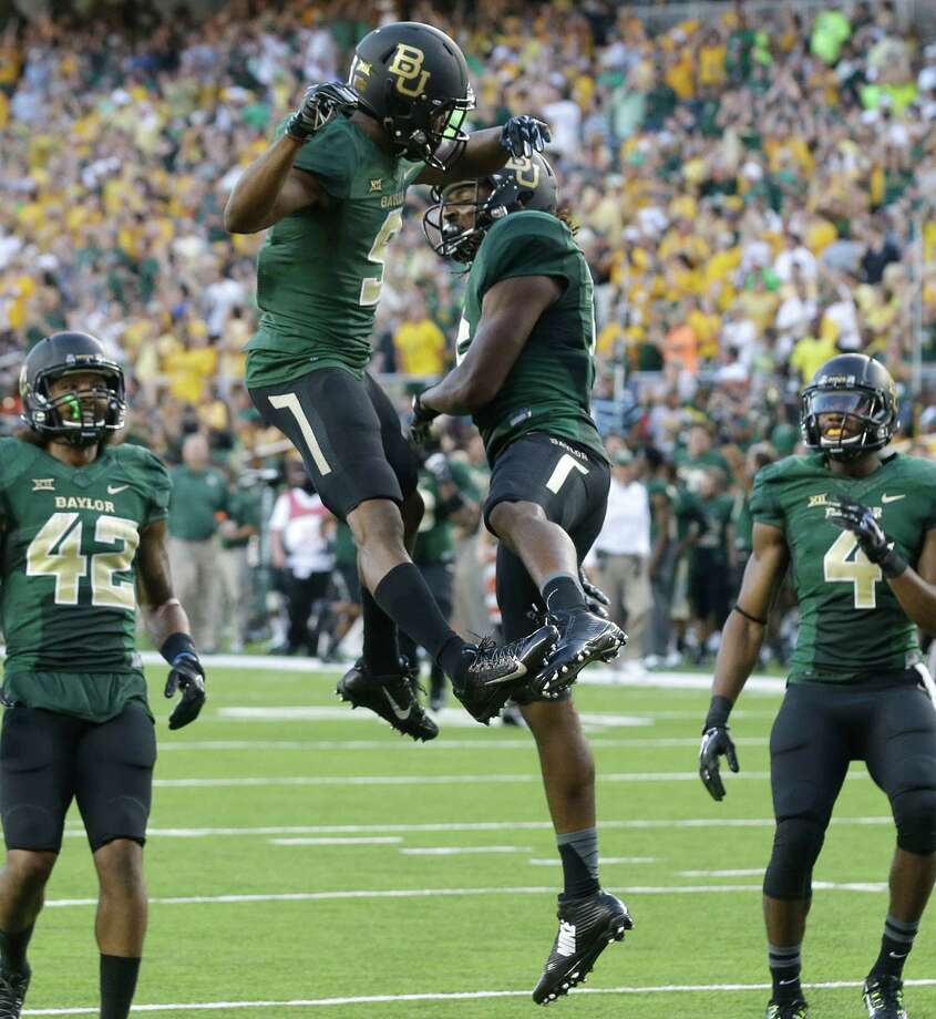 Baylor wide receiver KD Cannon (9) celebrates his touchdown catch with teammate Davion Hall (16) as Levi Norwood (42) and Jay Lee (4) look on during the first half of an NCAA college football game against SMU Sunday, Aug. 31, 2014, in Waco, Texas. (AP Photo/LM Otero) Photo: LM Otero, Associated Press / AP