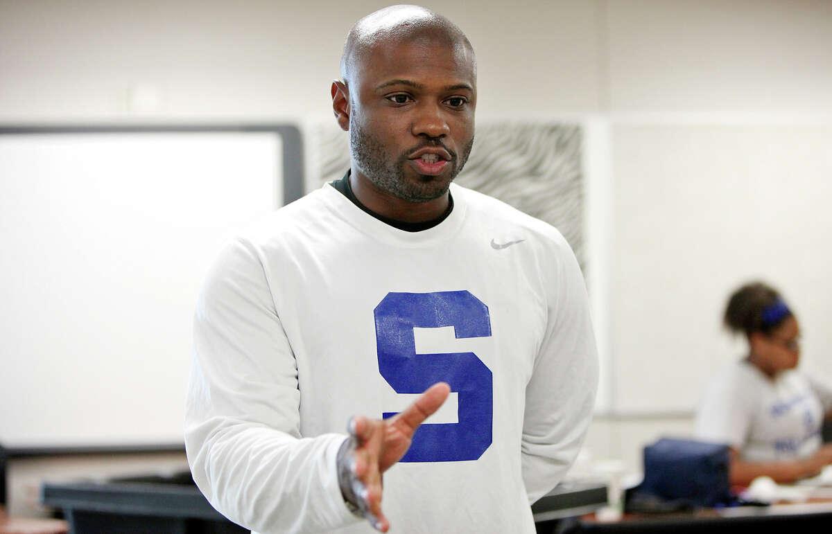 Somerset Junior High School 8th grade math teacher Joshua Harrison answers questions Thursday Aug. 21, 2014 at the school.