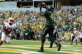 Baylor tight end Tre'Von Armstead (41) catches a touchdown in front of SMU linebacker Cameron Nwosu (52) during the first half of an NCAA college football game Sunday, Aug. 31, 2014, in Waco, Texas. (AP Photo/LM Otero)
