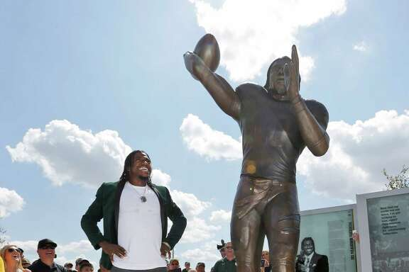 It was a big day for Baylor quarterbacks past and present. Before the game, Robert Griffin III, left, who stood out as the winner of the Heisman Trophy in 2011, saw himself portrayed in a 91/2-foot bronze statue that is one of the attractions outside the new McLane Stadium. During the game, Bryce Petty scored on a 5-yard run and threw two touchdown passes as the Bears rolled past SMU to complete a grand opening. But Petty suffered a bruised back on the TD run and sat out the second half.