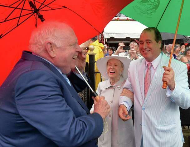 Retiring track announcer Tom Durkin, left, is greeted in the winner's circle by Mary Lou Whitney, center and John Hendrickson Sunday afternoon Aug. 31, 2014  at the Saratoga Race Course in Saratoga Springs, N.Y.     (Skip Dickstein/Times Union) Photo: SKIP DICKSTEIN