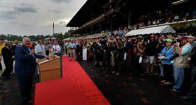 Track announcer Tom Durkin, left, is given a retirement party in the winner's circle Sunday afternoon Aug. 31, 2014  at the Saratoga Race Course in Saratoga Springs, N.Y.     (Skip Dickstein/Times Union) Photo: SKIP DICKSTEIN