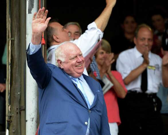 Track announcer Tom Durkin, center, waves to the crowd as he defends the stairs to attend his retirement party in the winner's circle Sunday afternoon Aug. 31, 2014  at the Saratoga Race Course in Saratoga Springs, N.Y.     (Skip Dickstein/Times Union) Photo: SKIP DICKSTEIN