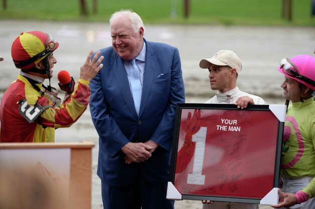 Track announcer Tom Durkin, center, is given a retirement gift in the winner's circle  by jockey John Velazquez, left Javier Castellano, second from right and Joe Bravo Sunday afternoon Aug. 31, 2014  at the Saratoga Race Course in Saratoga Springs, N.Y.     (Skip Dickstein/Times Union) Photo: SKIP DICKSTEIN