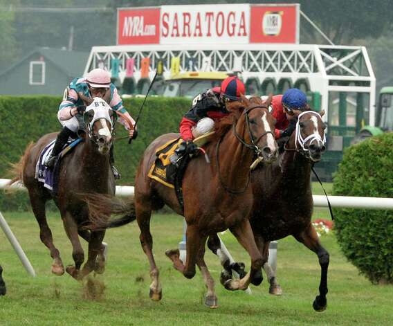 Irish Mission, center with jockey John Velazquez flies to the finish and the win in the 19th running of The Glens Falls Sunday afternoon Aug. 31, 2014 at the Saratoga Race Course in Saratoga Springs, N.Y.     (Skip Dickstein/Times Union) Photo: SKIP DICKSTEIN
