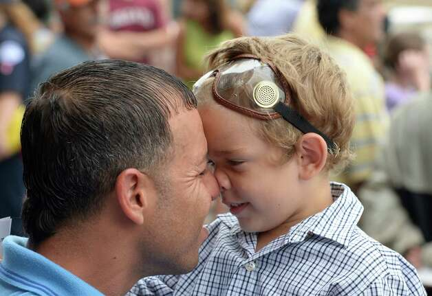 Joshua Rohena 4, and his dad Jose Rohena scruch noses while waiting for the next race to go off Sunday afternoon Aug. 31, 2014 at the Saratoga Race Course in Saratoga Springs, N.Y.     (Skip Dickstein/Times Union) Photo: SKIP DICKSTEIN