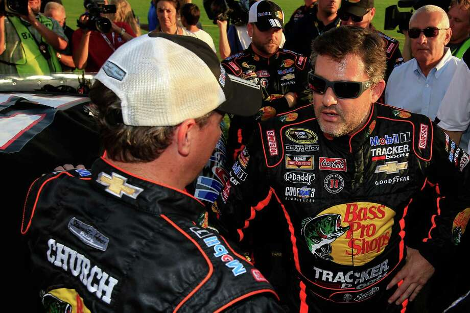 HAMPTON, GA - AUGUST 31:  Tony Stewart, driver of the #14 Bass Pro Shops / Mobil 1 Chevrolet, stands on the grid prior to the NASCAR Sprint Cup Series Oral-B USA 500 at Atlanta Motor Speedway on August 31, 2014 in Hampton, Georgia.  (Photo by Jamie Squire/Getty Images) ORG XMIT: 464040541 Photo: Jamie Squire / 2014 Getty Images