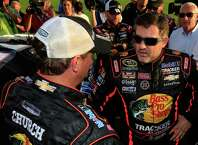 HAMPTON, GA - AUGUST 31:  Tony Stewart, driver of the #14 Bass Pro Shops / Mobil 1 Chevrolet, stands on the grid prior to the NASCAR Sprint Cup Series Oral-B USA 500 at Atlanta Motor Speedway on August 31, 2014 in Hampton, Georgia.  (Photo by Jamie Squire/Getty Images) ORG XMIT: 464040541