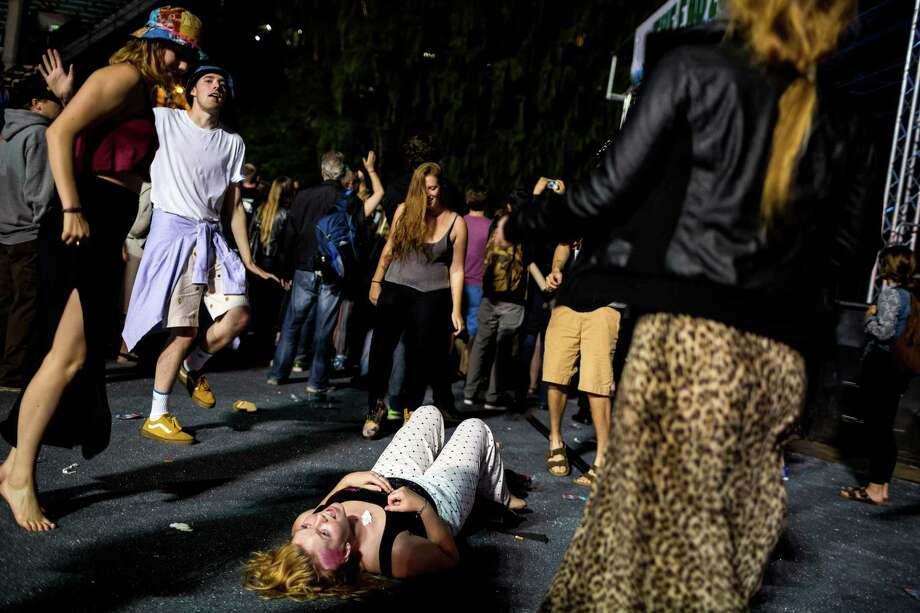 A downed woman is the centerpiece for a dance-off on the second day of Bumbershoot, Seattle's annual music and arts festival, photographed Sunday, August 31, 2014, in Seattle, Washington. Photo: JORDAN STEAD, SEATTLEPI.COM / SEATTLEPI.COM