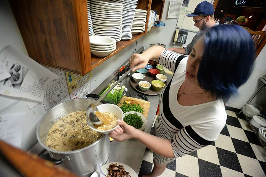 Victoria Walker cooks up ramen bowls at the Logon Cafe on Thursday. Walker is offering tastings to help finance owning her own ramen restaurant. Photo taken Thursday, August 14, 2014 Guiseppe Barranco/@spotnewsshooter