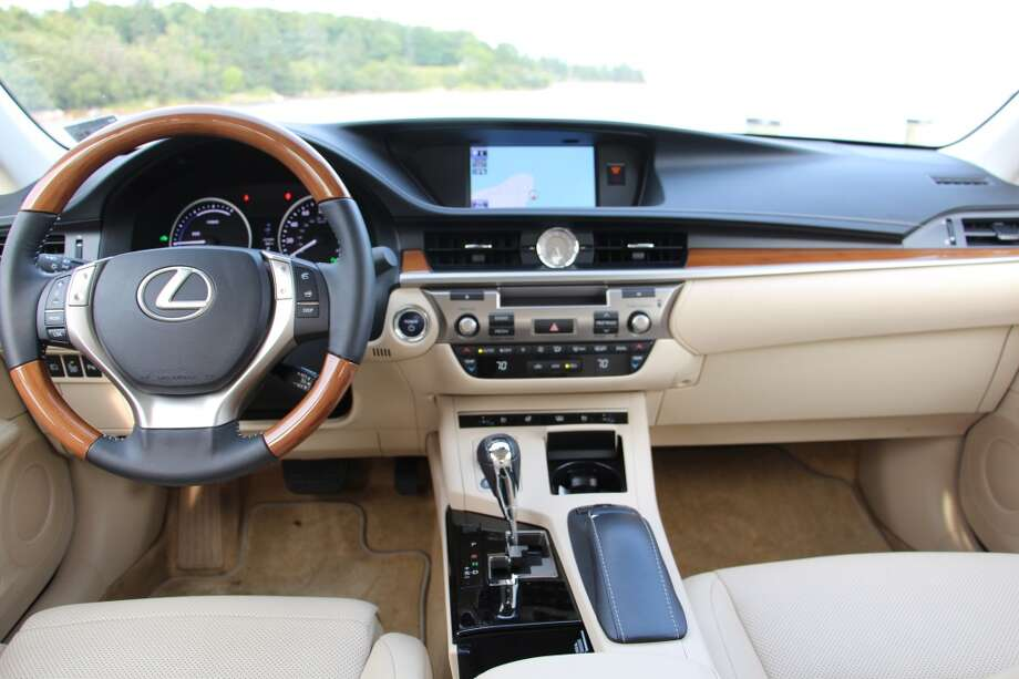 "Some of the extras installed on our tester: a $2,625 navigation system with backup camera and DVD/CD player. ""Ultra Luxury Package,"" at $2,435, gave us the bamboo trim, memory and heated/ventilated front seats, sunshades for the rear half of the passenger compartment and ""ambient lighting."""