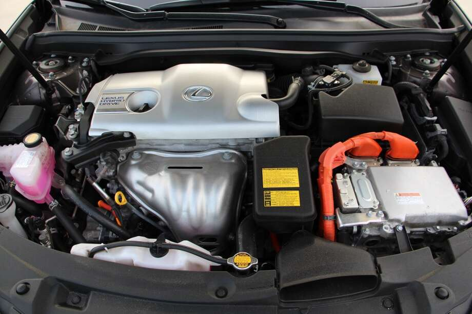 Hybrid systems usually have that telltale orange tubing that alerts you to the fact that electricity plays a prominent role in the motive power of this car.