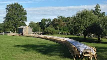 """""""Outstanding in the Field"""" comes to The Hickories in Ridgefield September 4 & 5. Guests sit at a long table on a local farm while a chef prepared a beautiful meal. Bill Taibe of  LeFarm & The Whelk comes to the Hickories on September 4 while Wirt Cook of the Redding Roadhouse comes on the 5th."""