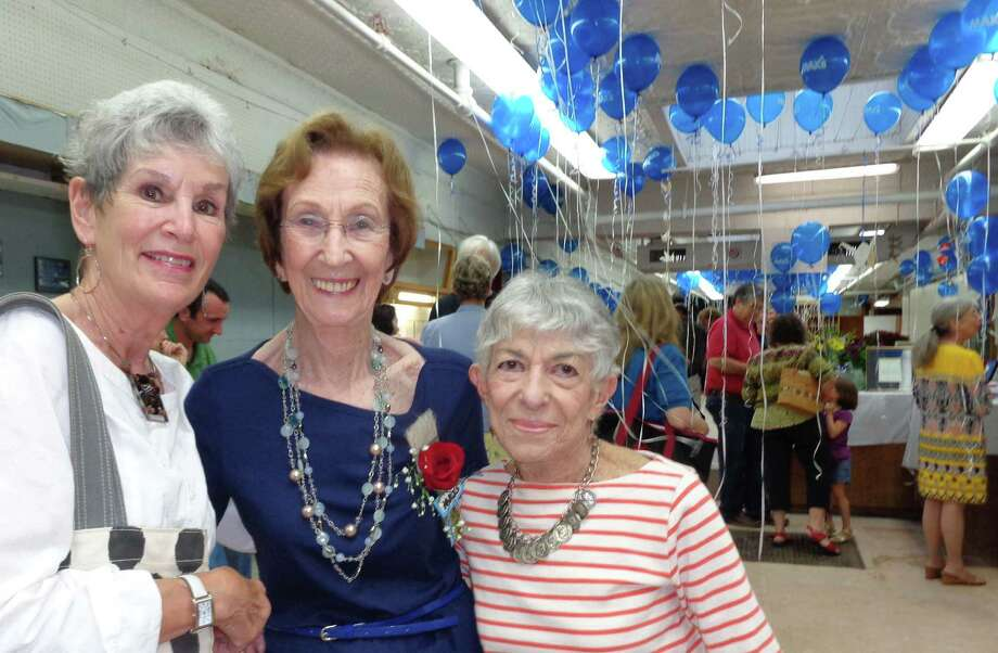 Max's Art Supplies' owner Shirley Mellor, center, shared memories with hundreds of well-wishers at Sunday's closing day party for the store after nearly six decades downtown. She is flanked by two Westport artists -- Julie Fatherley, left, and Naiad Einsel. Photo: Meg Barone / Westport News