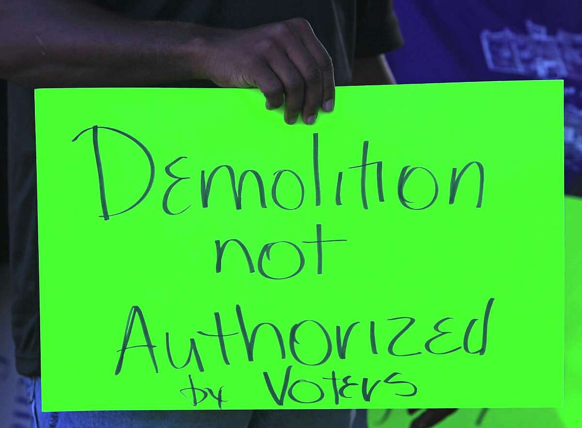 A sign carried as community leaders protest the demolition of the historic Wheatley / E. O. Smith school in the Fifth Ward Monday, Sept. 1, 2014, in Houston.