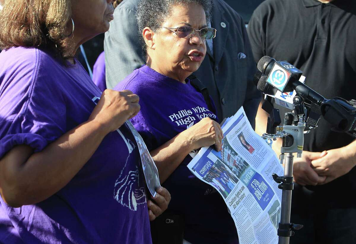 Ida Powell speaks along with community leaders during a protest rally on the demolition of the historic Wheatley / E. O. Smith school in the Fifth Ward Monday, Sept. 1, 2014, in Houston.