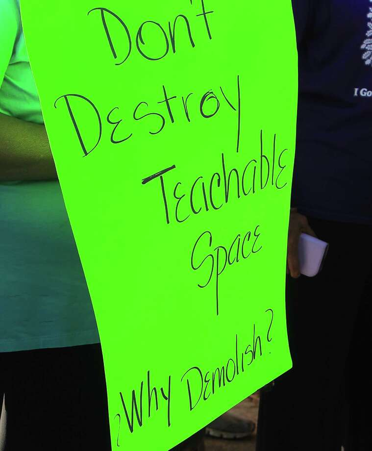 A protestor's sign as Community leaders protest the demolition of the historic Wheatley / E. O. Smith school in the Fifth Ward Monday, Sept. 1, 2014, in Houston. Photo: James Nielsen, Houston Chronicle / © 2014  Houston Chronicle