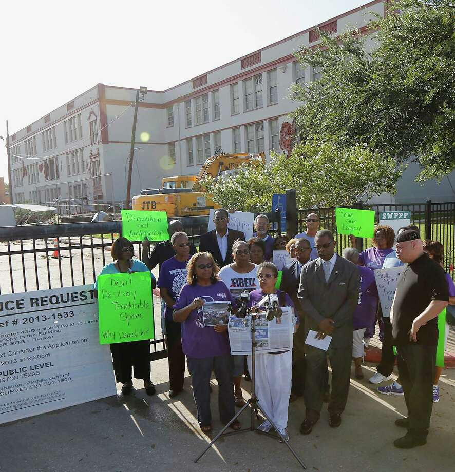 Community leaders protest the demolition of the historic Wheatley / E. O. Smith school in the Fifth Ward Monday, Sept. 1, 2014, in Houston. Photo: James Nielsen, Houston Chronicle / © 2014  Houston Chronicle