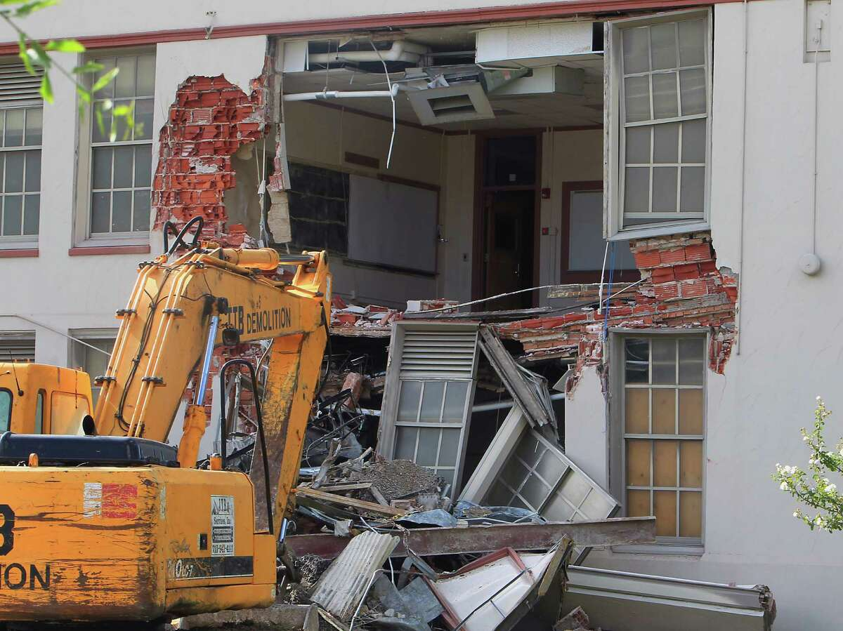 A parked excavator as community leaders protest the demolition of the historic Wheatley / E. O. Smith school in the Fifth Ward Monday, Sept. 1, 2014, in Houston.