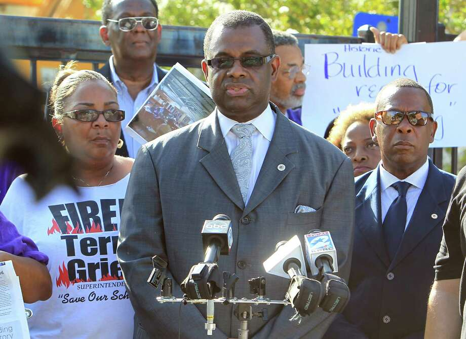 Robert Muhammed speaks as community leaders protest the demolition of the historic Wheatley / E. O. Smith school in the Fifth Ward Monday, Sept. 1, 2014, in Houston. Photo: James Nielsen, Houston Chronicle / © 2014  Houston Chronicle