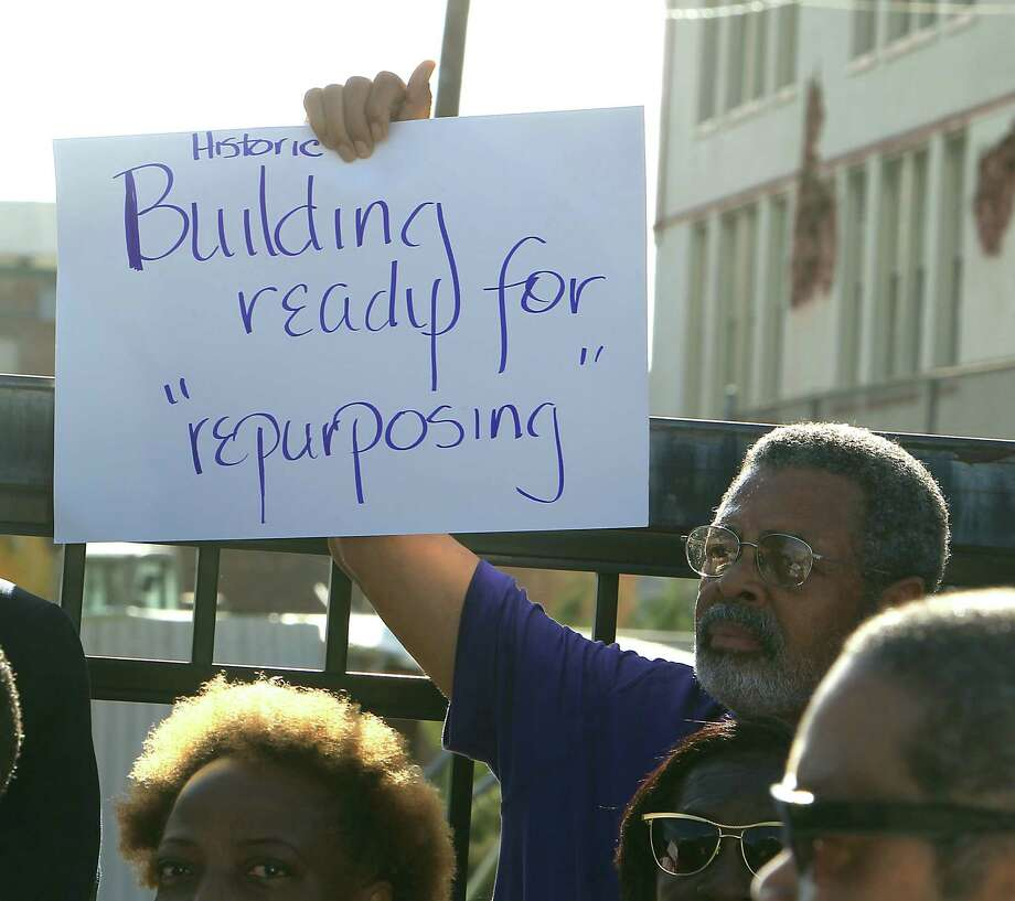 A protestor holds up a sign as community leaders protest the demolition of the historic Wheatley / E. O. Smith school in the Fifth Ward Monday, Sept. 1, 2014, in Houston. Photo: James Nielsen, Houston Chronicle / © 2014  Houston Chronicle