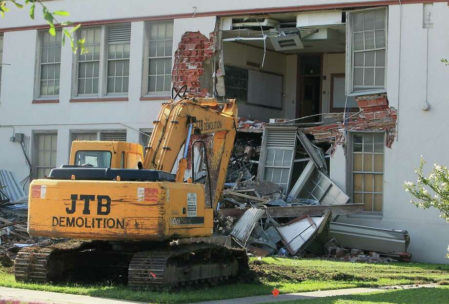 A parked excavator as community leaders protest the demolition of the historic Wheatley / E. O. Smith school in the Fifth Ward Monday, Sept. 1, 2014, in Houston. Photo: James Nielsen, Houston Chronicle / © 2014  Houston Chronicle