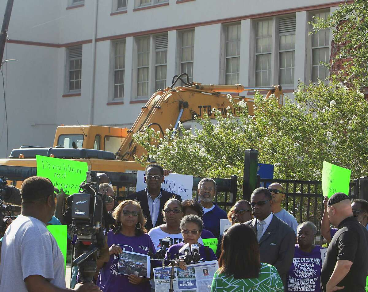 Community leaders protest the demolition of the historic Wheatley / E. O. Smith school in the Fifth Ward Monday, Sept. 1, 2014, in Houston.
