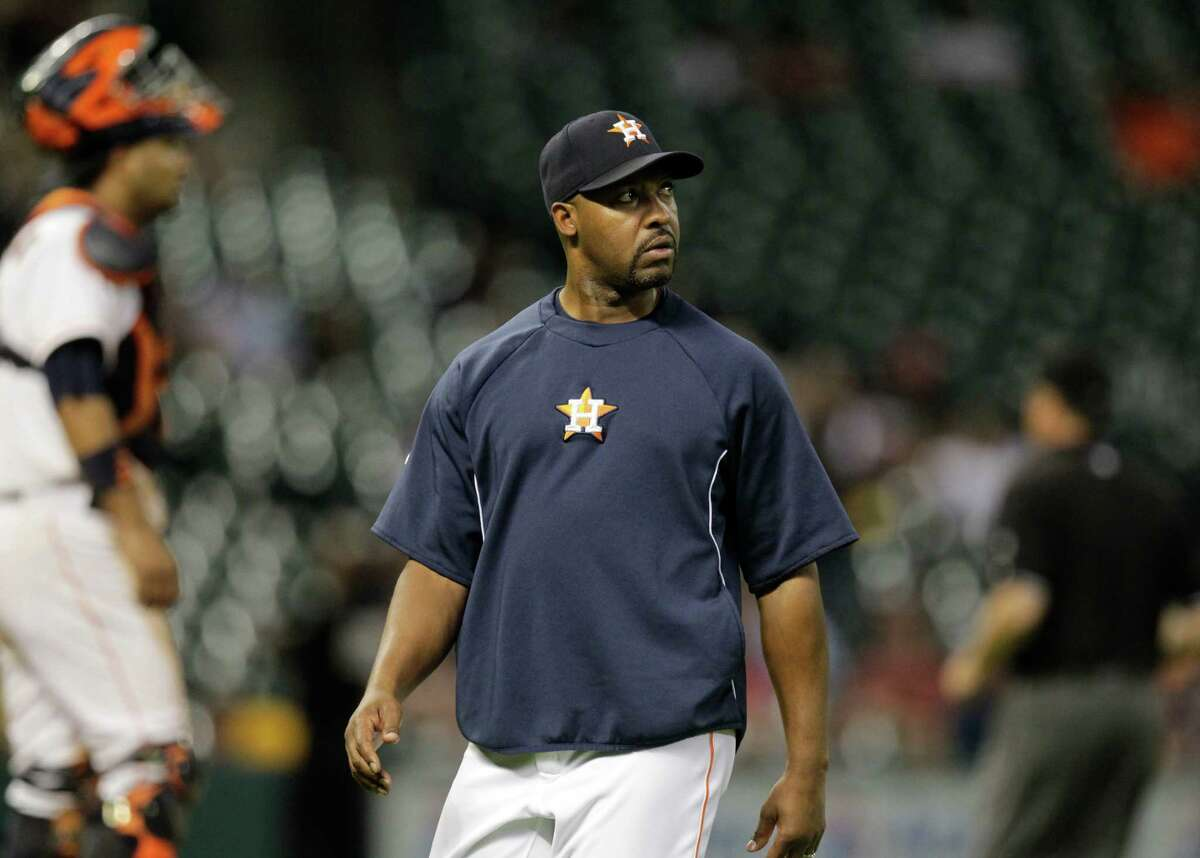 Houston Astros manager Bo Porter watches video screen after challenging a second base call during the 9th inning against the Oakland Athletics at Minute Maid Park Wednesday, Aug. 27, 2014, in Houston. After reviewing the call was upheld.