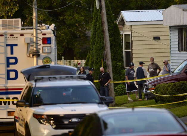 Troy police were at 709 First Ave., on Wednesday, Aug. 20 to investigate the beating deaths of Al and Maria Lockrow. Police acknowledged Sept. 1, 2014 that their stolen SUV had been found, but no arrests made. (Skip Dickstein / Times Union)