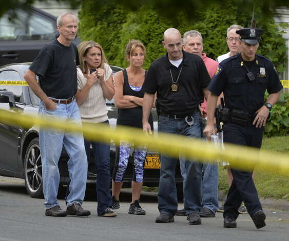 Family and friends arrived as Troy Police investigated a double homicide at 709 First Ave. Wednesday morning, Aug. 20, 2014. On Sept. 1, police acknowledged they found the victims' SUV that was stolen on the night of the killings. But no arrest has been made. (Skip Dickstein/Times Union)