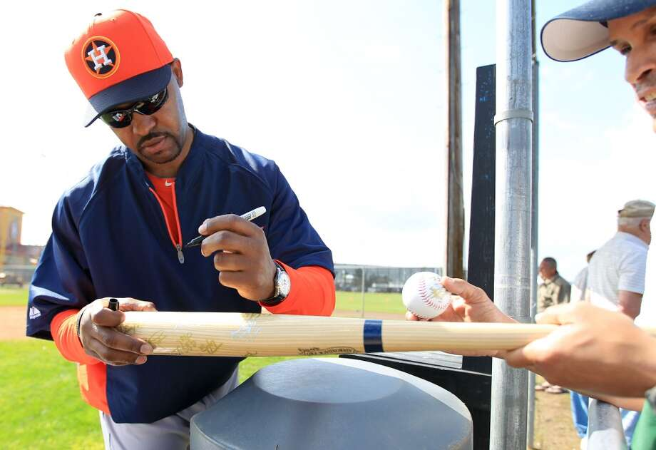 Houston Astros manager Bo Porter (16) signs autographs for fans at the Oseola County Stadium, Tuesday, Feb. 12, 2013, in Kissimmee, as pitchers and catchers get their first official workout completed on the first day of spring training.  ( Karen Warren / Houston Chronicle ) Photo: Karen Warren, Houston Chronicle